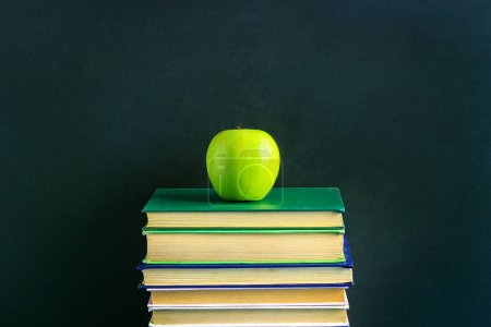 Photo for Green Apple on stack books on background of chalkboard. Copy space Concept back to school - Royalty Free Image