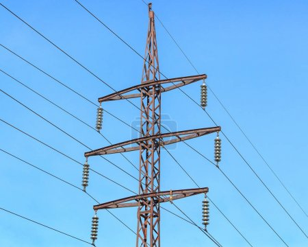 Photo for Metal support (elektroopora) of overhead power lines against a blue sky. - Royalty Free Image