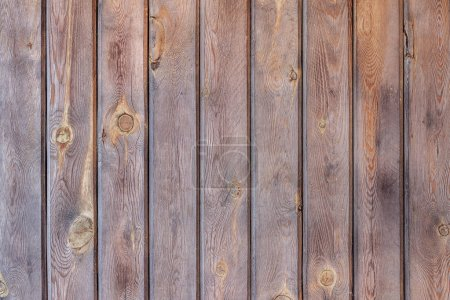 Photo for Rustic wall brown wooden planks boards, vertical pattern, natural color. Natural wooden background.Texture - Royalty Free Image
