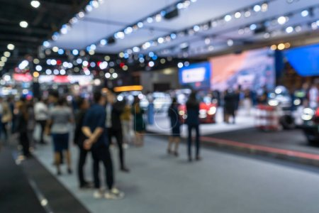 Photo for Abstract blurred background image of the crowded corridors and the booth stands in exhibition hall, Concept Motor Show, Motor Expo - Royalty Free Image