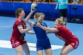 ZAGREB, CROATIA - MAY 7, 2017: Finals of EHF Challenge Cup Lokomotiva vs. Hoors. LUKIC Dora (13) in action, blocked by two players