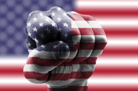 American flag on fist and American flag background