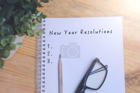 Photo for New Year Resolutions words on a notepad - Royalty Free Image