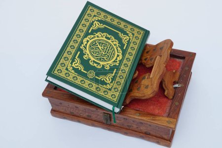 Photo for Muslim Coran on wooden book stand on white background - Royalty Free Image