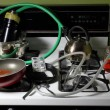 Crudely constructed meth lab on a stove top consis...