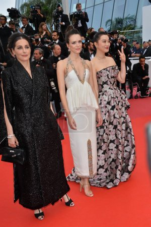 """Photo for CANNES, FRANCE. May 24, 2019: Amira Casar, Stacy Martin & Huang Lu  at the gala premiere for """"Sybil"""" at the Festival de Cannes - Royalty Free Image"""
