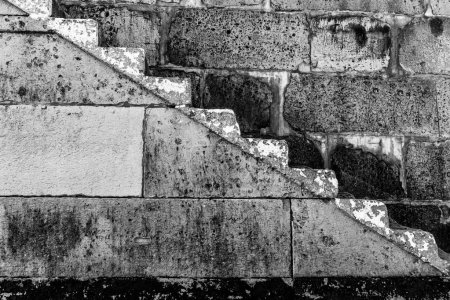 Black and white photo of the steps in the harbour wall