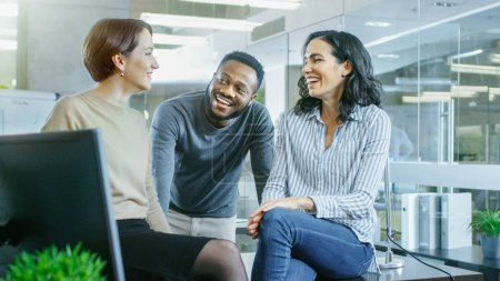 Photo for Diverse Group of Talented Young Professionals Chatting, Joking and Having Fun on a Coffee Break. Stylish Young People in Modern Office. - Royalty Free Image