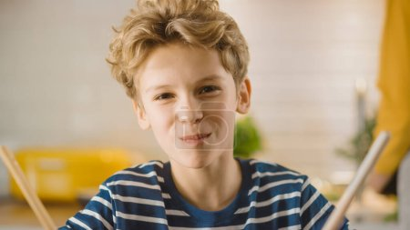 Photo for In Kitchen: Little Boy Smiling at the Camera with Mouth full of Food Snacks. Healthy Dinner. Little Son Study Healthy Habits. - Royalty Free Image