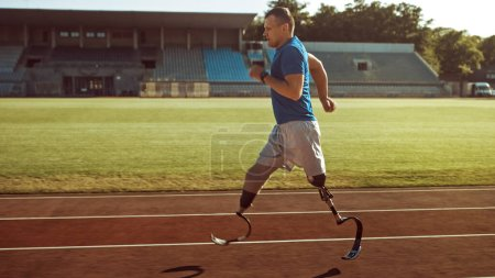 Photo for Athletic Disabled Fit Man with Prosthetic Running Blades is Training on an Outdoors Stadium on a Sunny Afternoon. Amputee Runner Jogging on a Stadium Track. Motivational Sports Shot. - Royalty Free Image