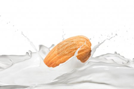 Photo for Almond and milk with splashes on white background - Royalty Free Image