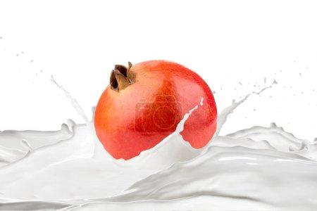 Photo for Fresh pomegranate and milk with splashes on white background - Royalty Free Image