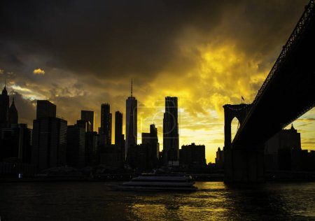 Photo for New York City Manhattan downtown skyline and Brooklyn bridge at sunset - Royalty Free Image