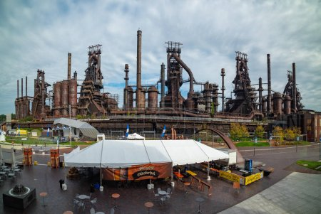 Photo for BETHLETEM, PA, UNITED STATES  OCTOBER 14, 2018: Panoramic view of Steel factory still standing in Bethlehem PA on cloudy day - Royalty Free Image