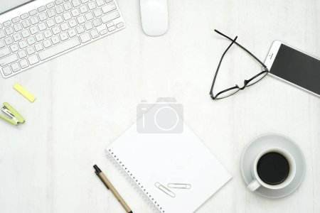 Photo for Top view wood work desk with laptop, smartphone, and supplies. - Royalty Free Image