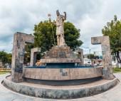 Pool with sculpture of the Inca in Plaza de armas of bathrooms del Inca in Cajamarca Peru