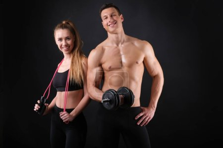 Photo for Fitness young man and woman isolated on black background. - Royalty Free Image