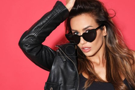 Portrait of sexy woman in black sunglasses.