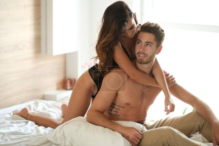 Photo for Pretty couple hugging in the bed. - Royalty Free Image