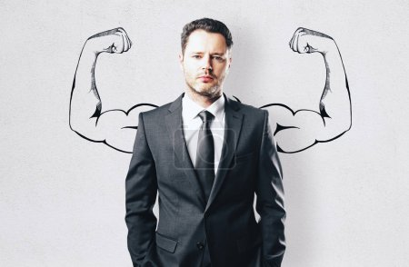 Photo for Portrait of attractive young businessman with drawn muscly arms. Confidence and power concept - Royalty Free Image