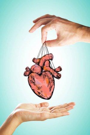 Photo pour Remise de coeur les gens esquisse sur fond clair. Concept de cardiologie et médecine - image libre de droit