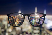 Abstract night city view through eyeglasses
