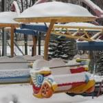 Carousel in the snow, a bright multi-colored fun r...