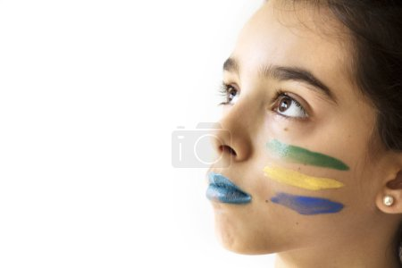 emotional kid football fan posing on white background