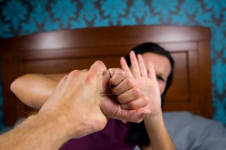 Photo for Wife with aggressive husband in domestic violence. - Royalty Free Image