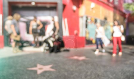 Photo for Defocused bokeh abstract view of stars sidewalk with everyday people and tousists around the world famous Walk Of Fame on Hollywood Boulevard in LA California - United States of America - Royalty Free Image