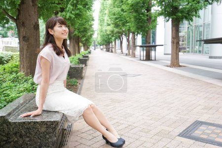 Young asian woman waiting on street...