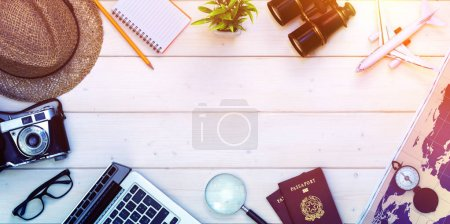 Photo for Travel Planning - Preparation For Holidays Trip - Passports And Objects On Desktop - Royalty Free Image