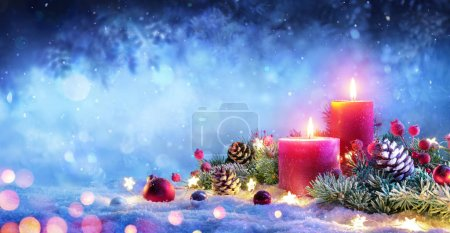 Photo for Christmas Advent - Red Candles With Ornament On Snow - Royalty Free Image