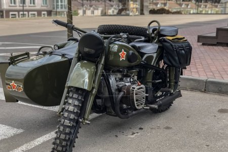 Russian retro motorcycle URAL khaki. Moto during the second world war with Soviet symbols