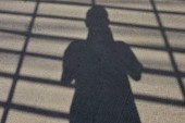 The shadow of human apper on the street.