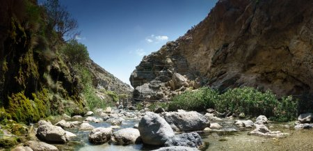 Photo for Stream flowing through rocks against mountain, Crete, Greece - Royalty Free Image