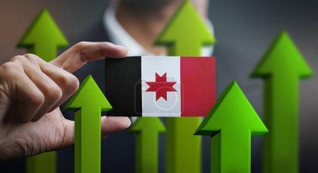 Photo pour Concept de croissance de la nation, Green Up Flèches - Homme d'affaires tenant la carte du drapeau de l'Oudmourtie - image libre de droit