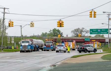 Photo for May 18 2018 Stevensville MI USA; a bad accident shows first res-ponders, police, fire truck and tow truck. Important workers when you need help - Royalty Free Image