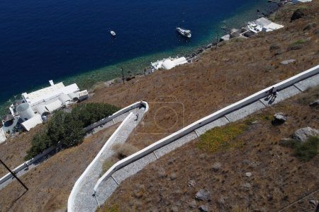 Photo for Aerial view of the path leading up the cliff from port on the village of Thirasia, Greece on August 16, 2020 - Royalty Free Image