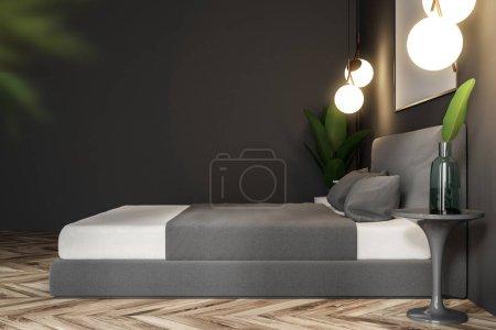 Photo pour Vue latérale d'une chambre intérieure avec des murs gris, un sol en bois, un lit double et une table de chevet avec des livres. Une affiche horizontale. Modélisation de rendu 3d - image libre de droit