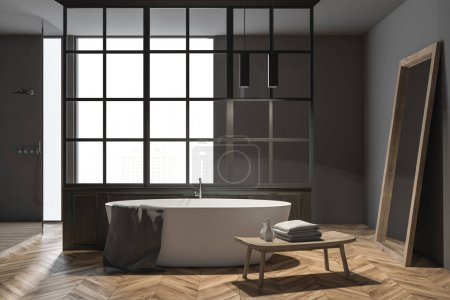 Gray wall bathroom interior with a wooden floor and a white tub with a mirror standing near it. A double sink and a table 3d rendering mock up