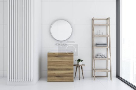 White tile bathroom interior with a white tile floor, a wooden sink with a round mirror hanging above it. Shelves. 3d rendering