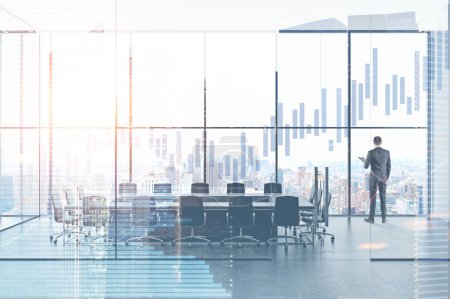 Photo for Rear view of a businessman standing in an office meeting room. Panoramic windows. Graphs in the foreground. 3d rendering mock up toned image double exposure - Royalty Free Image