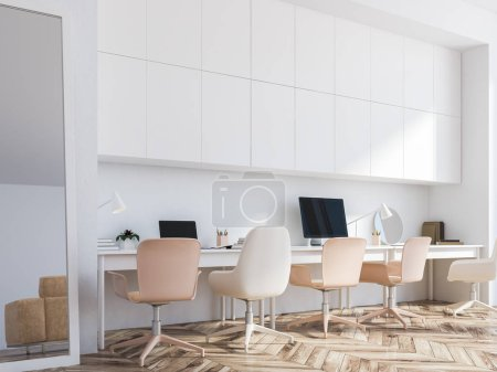 Photo for White home office corner with two tables with computer screens on them standing in a hipster room with white walls and closets and a vertical mirror on the floor. 3d rendering mock up - Royalty Free Image