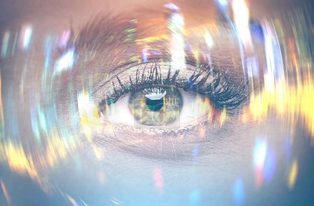 Photo for Close up of a beautiful woman eye with long eyelashes. Rays of light and splashes are around it. Abstract - Royalty Free Image