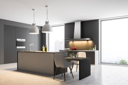 Loft kitchen corner with dark gray walls, a concrete floor and gray countertops with built in appliances and a table with chairs. 3d rendering mock up
