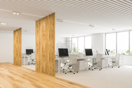 Photo for White and wooden open plan office corner with a white floor, loft windows and rows of computer tables. 3d rendering mock up - Royalty Free Image