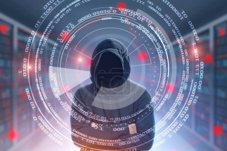 Unrecognizable young hacker in a black hoodie standing with crossed arms in a server room. Zeros and ones HUD and glowing malware network. Concept of cyber security. Toned image double exposure