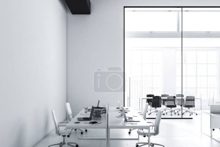 Photo for Side view of a modern international company office with white walls, a concrete floor and white computer desks standing in rows. Industrial style. Loft 3d rendering mock up - Royalty Free Image