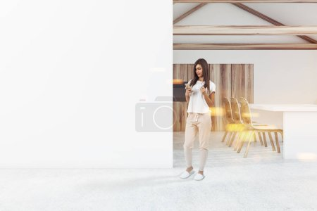 Attic kitchen interior with white walls and floor, panoramic windows and wooden countertops. A woman 3d rendering toned image A mock up wall to the left